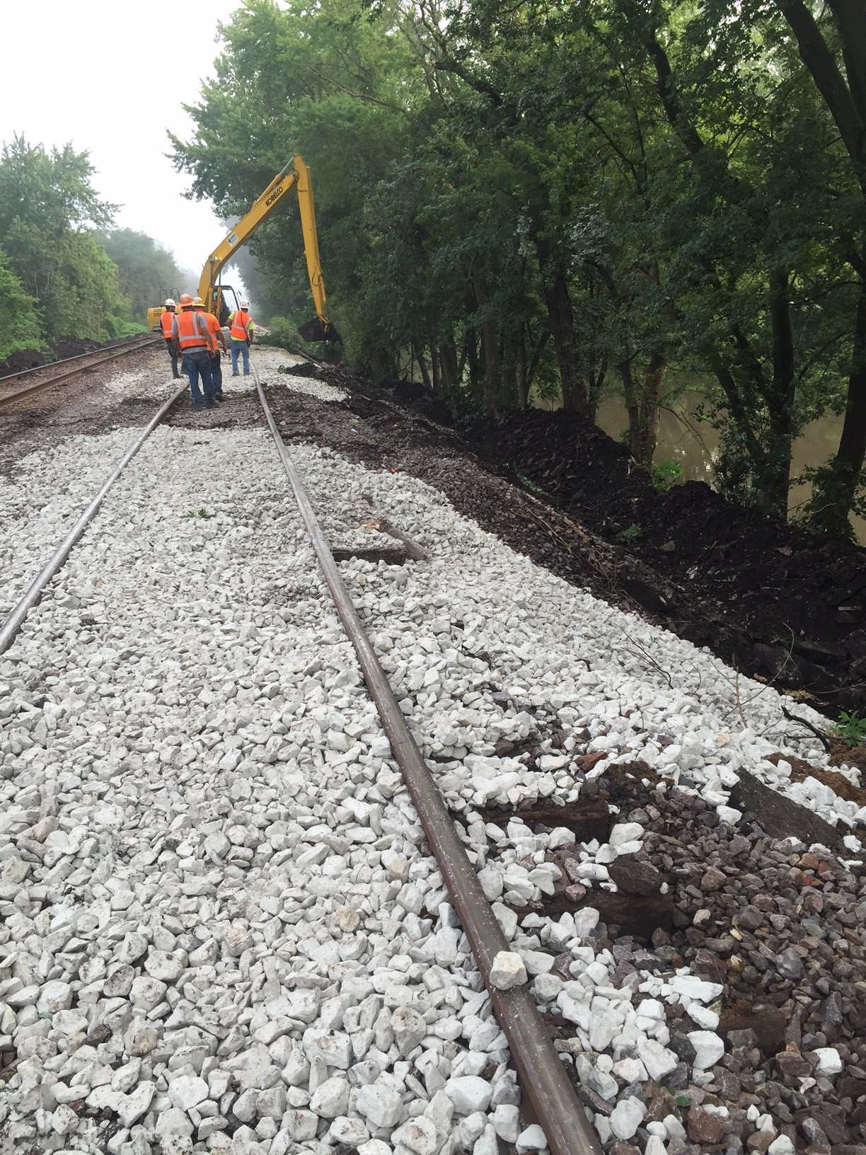 Snelten Inc. performing roadway maintenance on a railroad